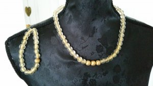 Collier de perles brun sable