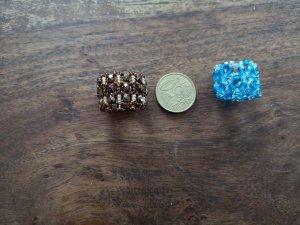 Bague incrustée de pierres brun foncé-bleu