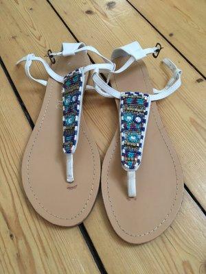 Sandalo toe-post bianco-azzurro