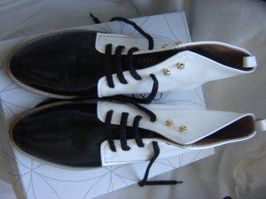 Prada Botas de tobillo negro-blanco Cuero