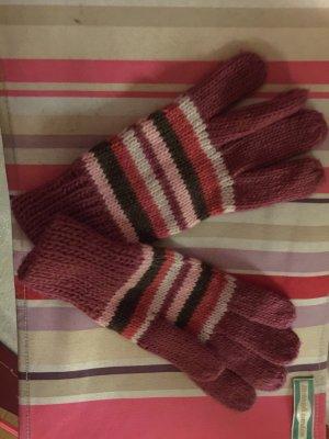 Pink gestreifte Handschuhe