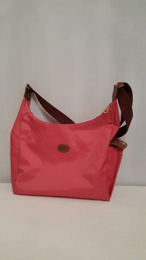 Pink-rosane Longchamp Tasche