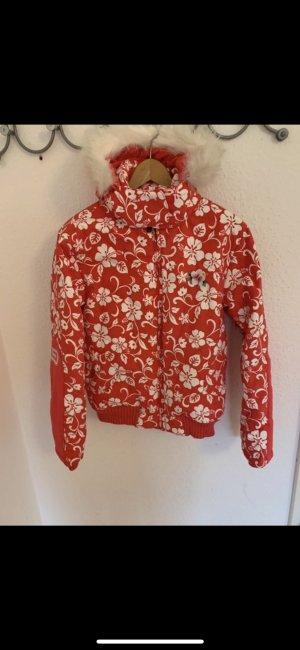 Pinke Retro Ski Jacke mit floralem Muster in weiß