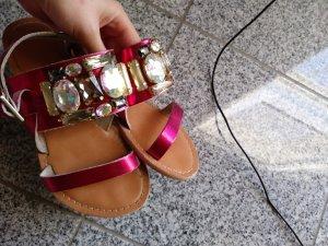 Pinke Sandalen mit Steinchen