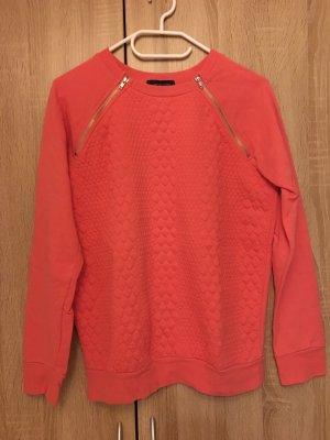 Pinker Pullover mit Reißverschlüssen