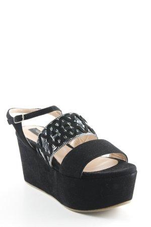 Sandalo alto con plateau nero stile stravagante