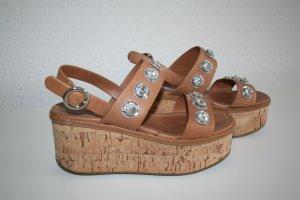Prada Sandales à plateforme chameau cuir