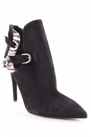 Poi Lei Cut Out Booties black-white animal pattern extravagant style