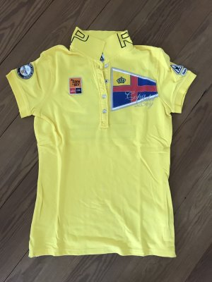 Poloshirt gelb mit Apllikationen