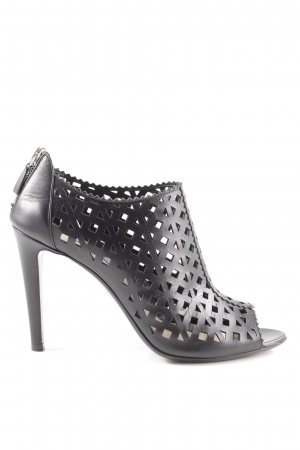 Prada Stivaletto cut out nero stile professionale