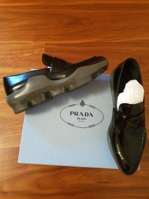 Prada Mokassins Slipper Gr. 38,5 Leder schwarz grau neuwertig