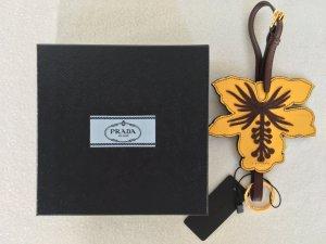 Prada, Schlüsselanhänger, Leder, gelb-braun, made in Italy, neu mit Karton