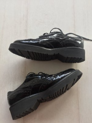Prada Chaussures à lacets noir