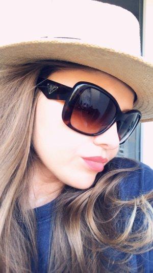 Prada Hoekige zonnebril zwart bruin