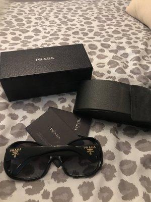 Prada Ovale zonnebril zwart-goud