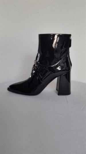 Prada Botas con cremallera negro Cuero