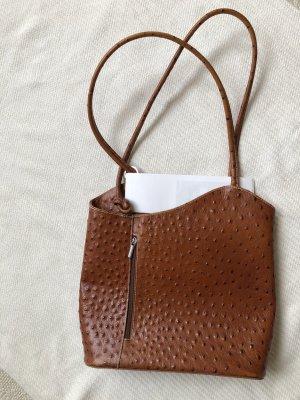 Praktische ledertasche, auch als rucksack verwendbar