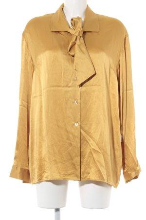 Prestige Elegance Blouse avec noeuds orange doré élégant