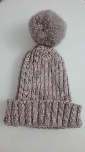 Chapeau en tricot beige pelage