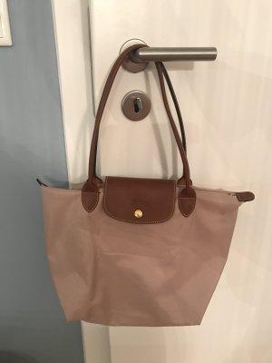 Puder- farbene Longchamp Tasche