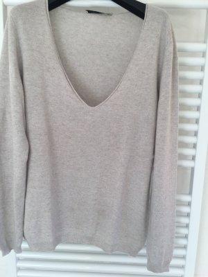 Jersey con cuello de pico color plata-gris claro