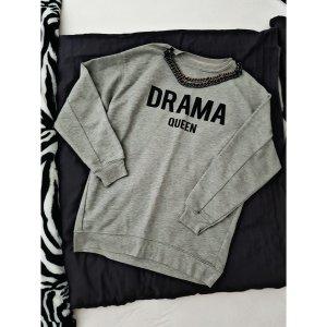 Pullover Größe 34 mit angenähter Kette