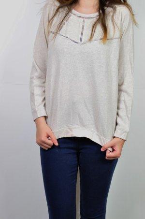 Pullover mit Ausstanzungen