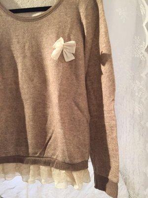 Pullover mit beigen Spitzeneinsätzen