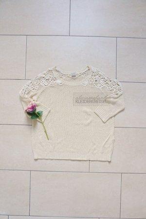 Pullover mit Crochet Ärmeln