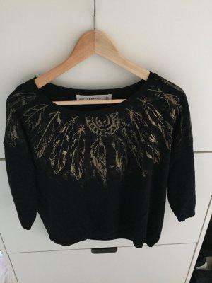 Pullover mit goldenen Federn