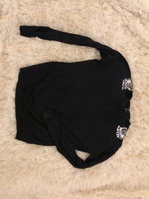 Pullover mit Klitzersteinen an der Schulter