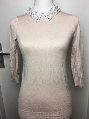 Pullover mit Perlen am Kragen