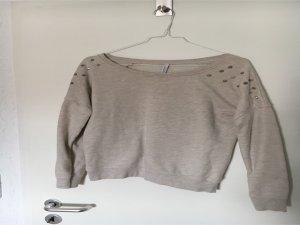 Pullover mit silbernen nieten