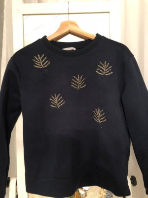 Pullover mit Verzierungen