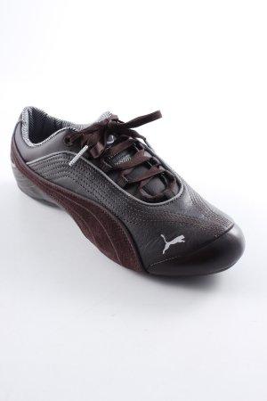 Puma Schnürsneaker dunkelbraun-silberfarben sportlicher Stil