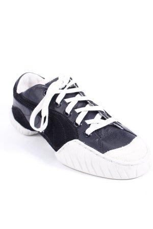 Puma Schnürsneaker schwarz-wollweiß sportlicher Stil