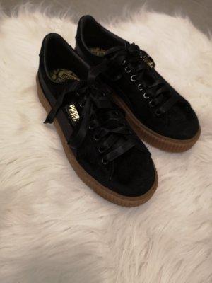 Puma Sneakers zwart-goud