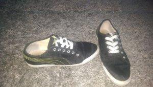 Puma Sneakers schwarz mit grünen Aplikkationen