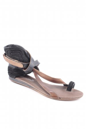 Puma Zehentrenner-Sandalen schwarz-bronzefarben Street-Fashion-Look