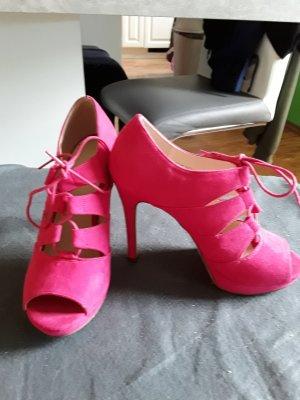 Tacones con cordones rosa