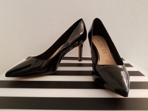 Pumps in schwarz aus Lackleder