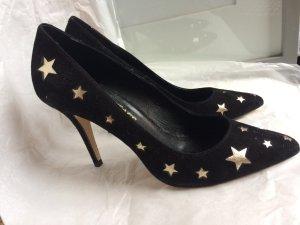 Pumps mit goldenen Sternen