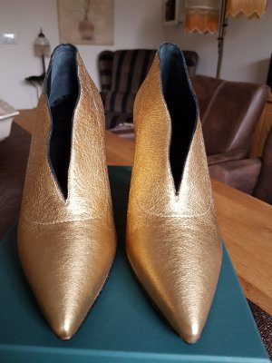 Pumps gold-colored leather