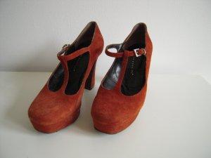 Andrea Puccini Strapped pumps dark orange leather
