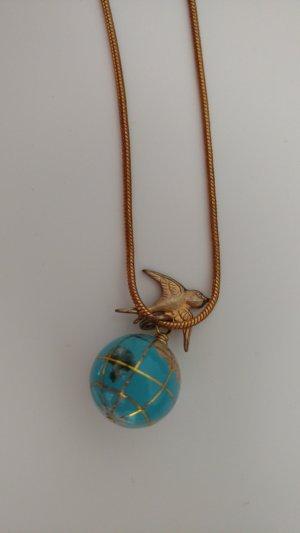 Retro Vogel und Globus Kette golden aus der National Gallery London.