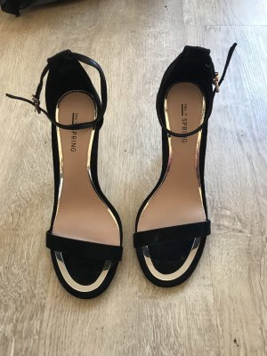 Strapped pumps black-gold-colored