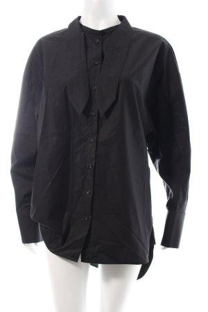 Rika Long-Bluse schwarz minimalistischer Stil