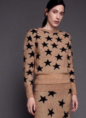 Rika Sternenpullover Star Sweater Rika Studios in Beige mit schwarzen Sternen