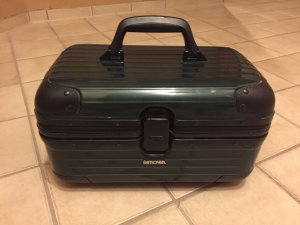 Suitcase dark green synthetic material