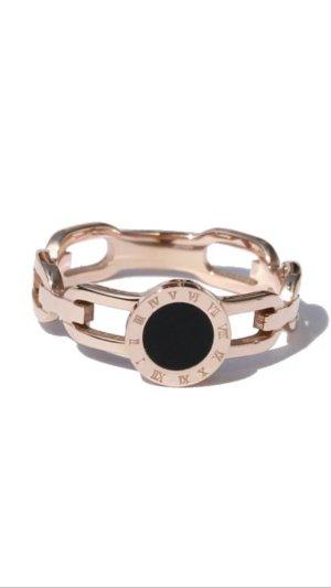 Bague incrustée de pierres or rose-noir